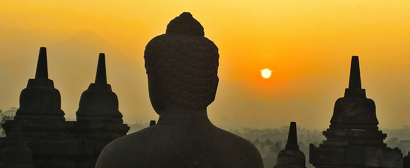 Temples and statues at sunrise