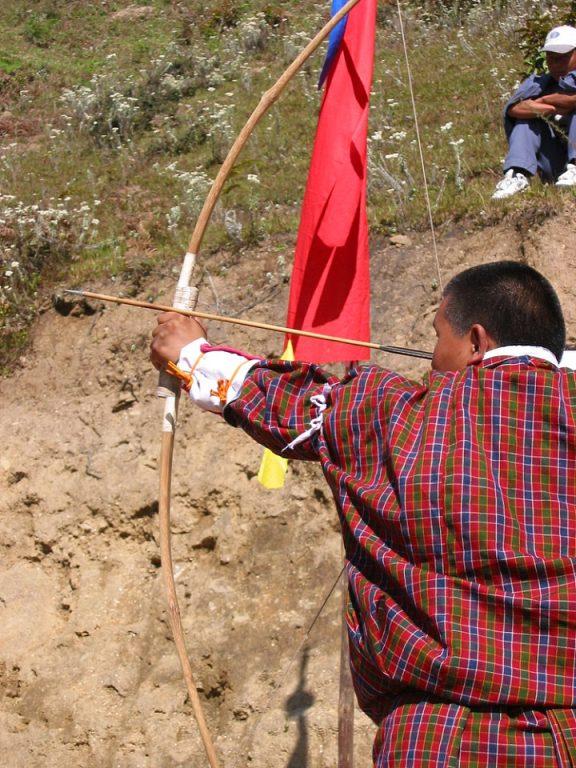 Man with archery bow and arrow in Bhutan