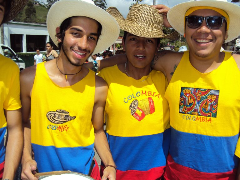 three young men in Colombia shirts