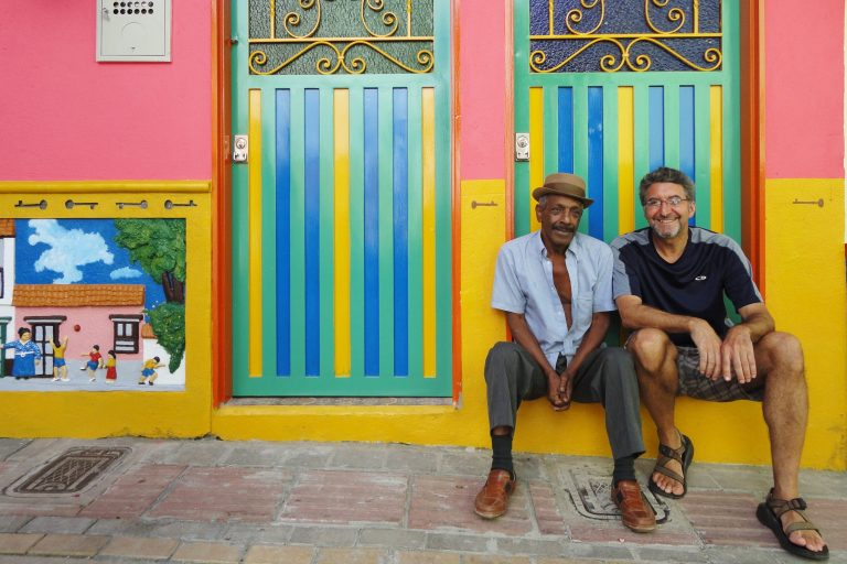 two men in colorful doorway