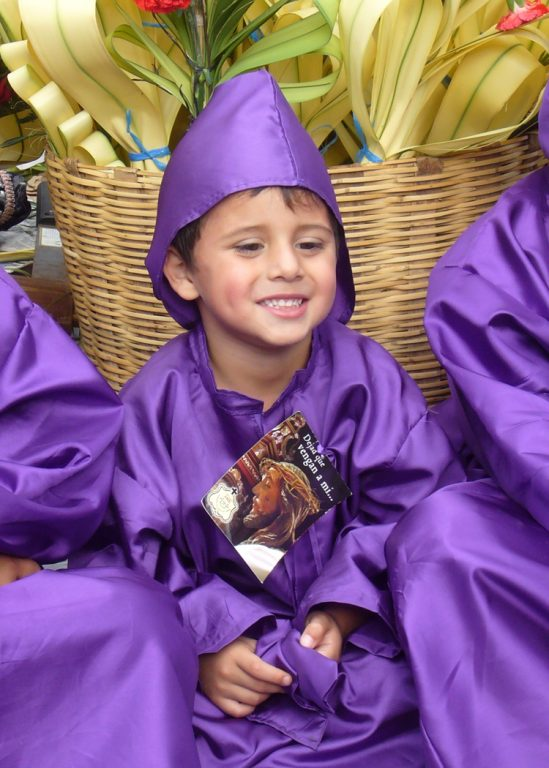 Boy in Palm Sunday robe and hood