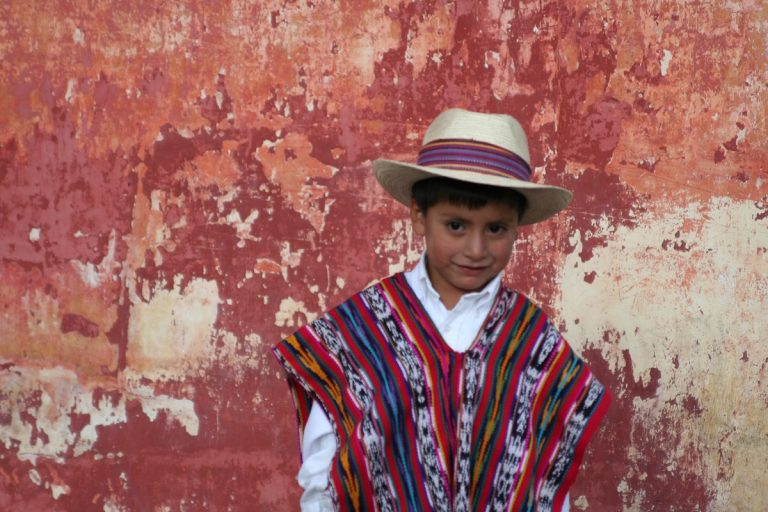 Guatemalan boy in front of colorful wall