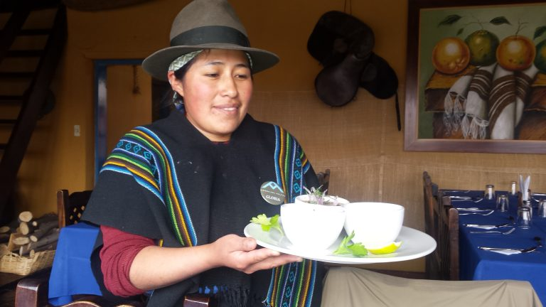 Ecuadorian woman serving dinner