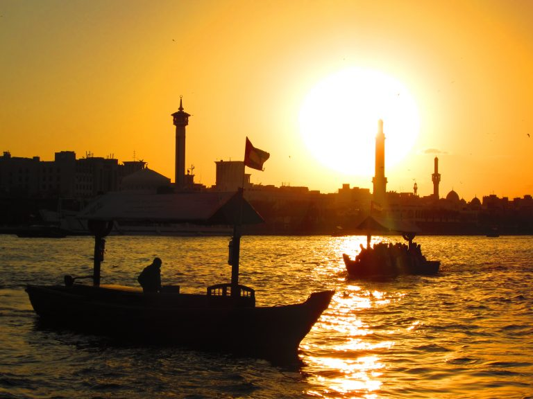 sunset with boats and minarets