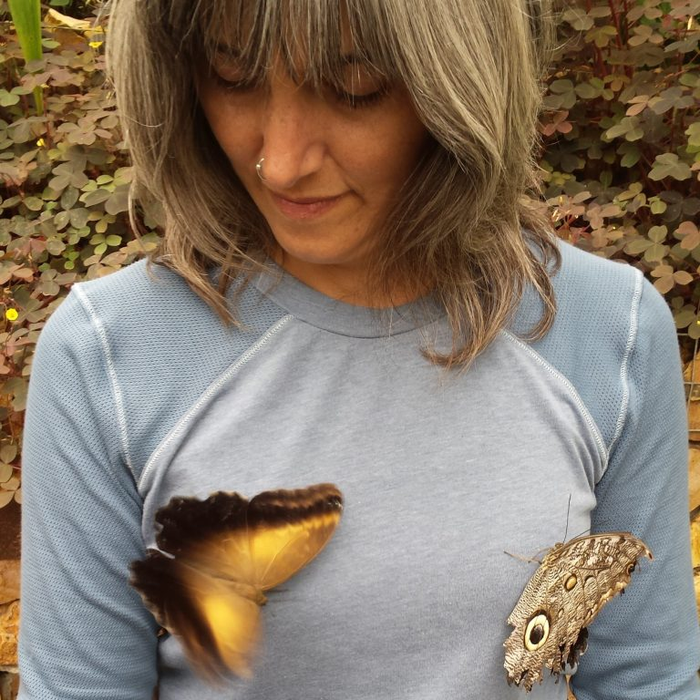 two butterflies on womans chest