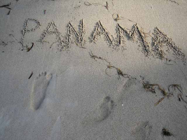 word Panama written in the sand