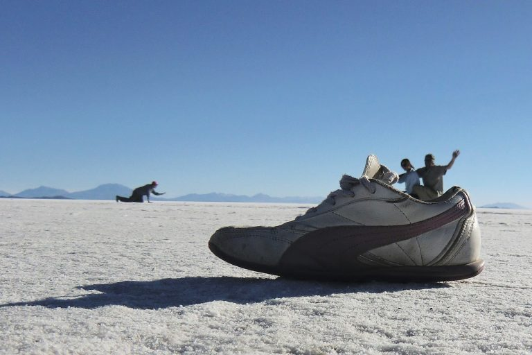 people inside a shoe a Salar de Uyuni, Bolivia