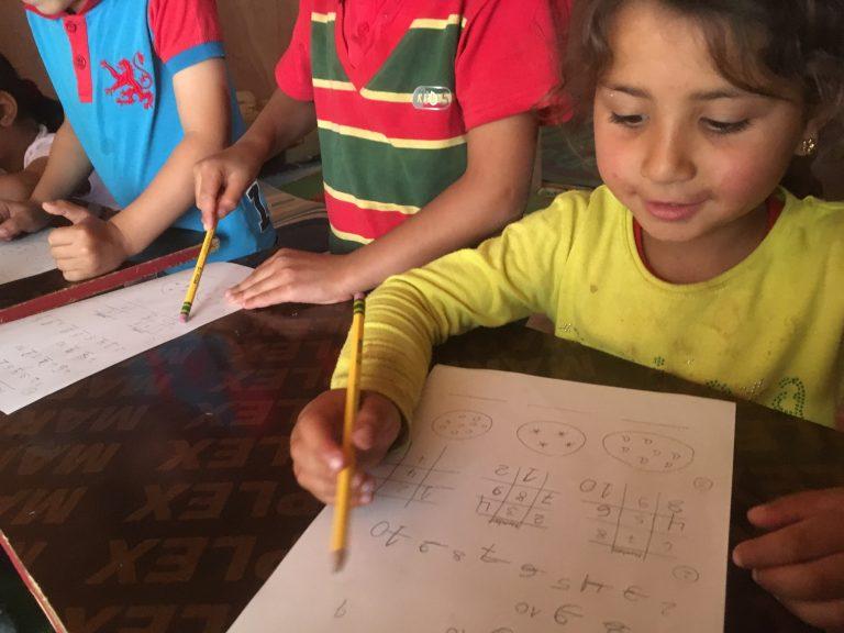 Syrian refugee girl attending school