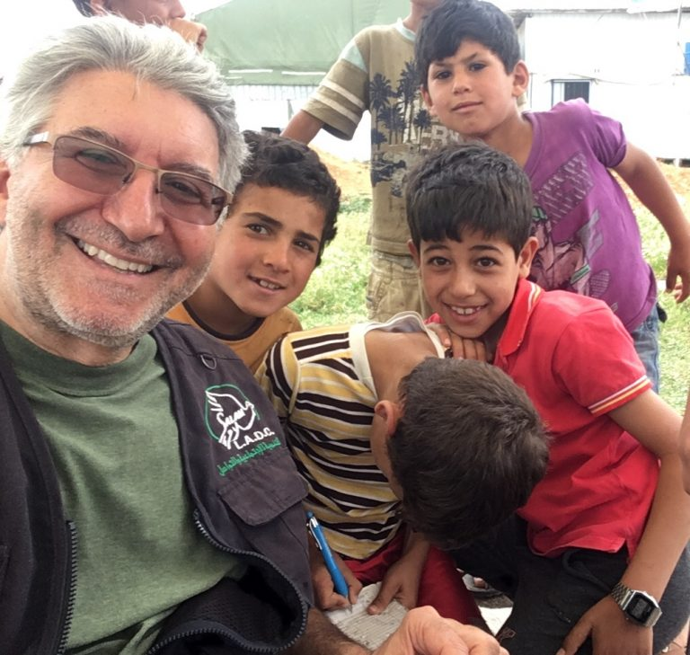 Joe Staiano volunteering with Syrian refugees